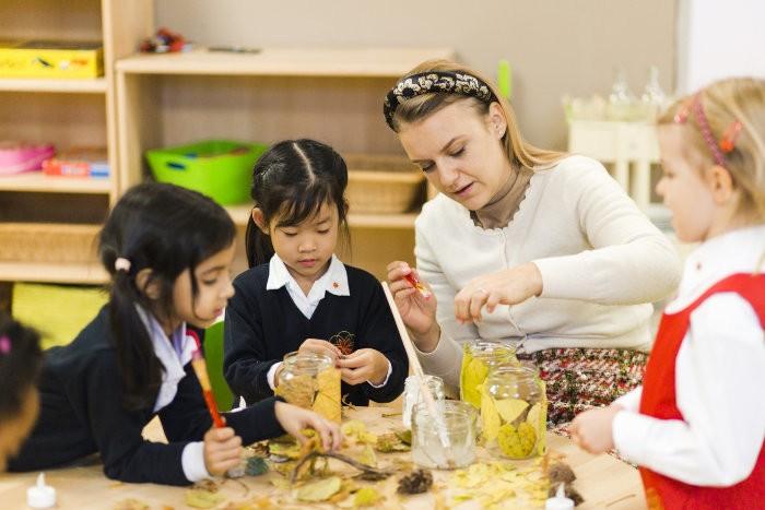 Children and teacher being creative in kindergarten in Vienna