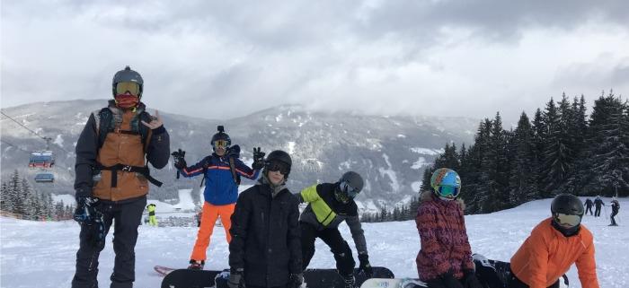 Skiers on piste