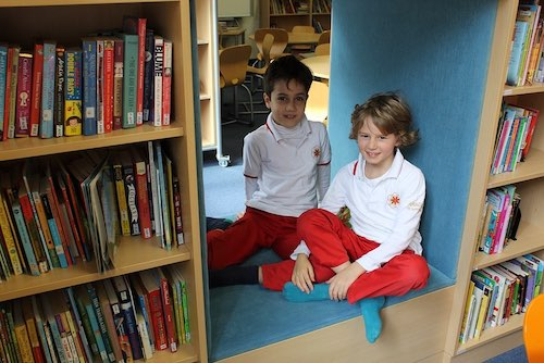 Two boys in school uniform at the library