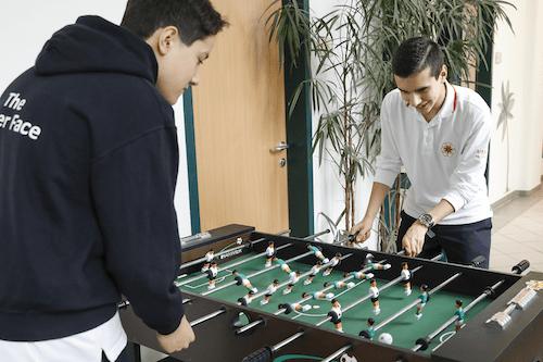 Two teenage boys playing Table Football