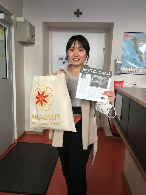 Girl holding a bag with AMADEUS logo