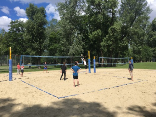 students and teachers playing beach volley