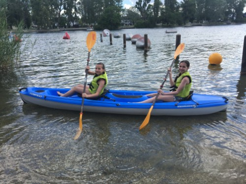 Two girls rowing in a kayak
