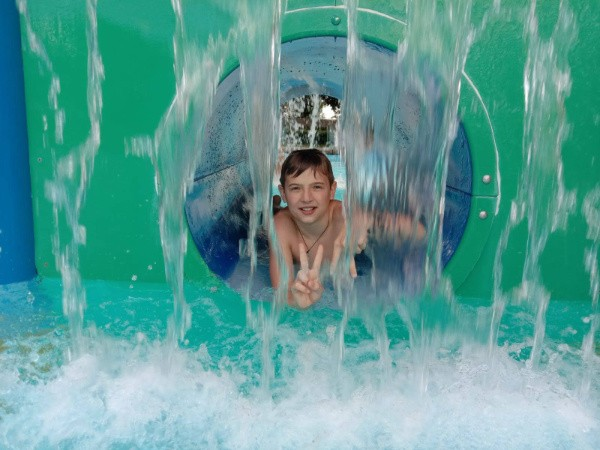 Boy in water slide