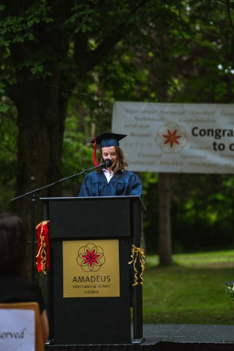 graduate holding a speech on stage