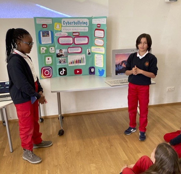 male and female student presenting their project in front of class